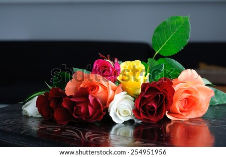 Roses on Vintage Table - stock photo