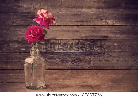 roses on wooden background - stock photo