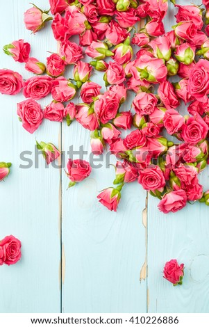 Roses on wooden background with place for text - stock photo