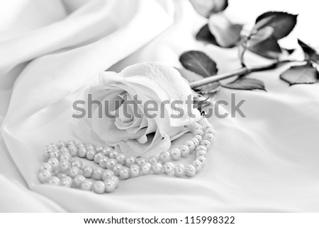 Roses with pearls in black and white - stock photo
