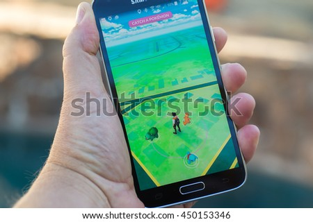 Roseville, CA - July 10: An Android user plays Pokemon Go, a free-to-play augmented reality mobile game developed by Niantic for iOS and Android devices. - stock photo