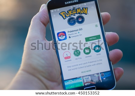 Roseville, CA - July 10: An Android user prepares to install Pokemon Go, a free-to-play augmented reality mobile game developed by Niantic for iOS and Android devices. - stock photo