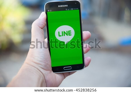 Roseville, CA/USA - July 15, 2016: An Android user installs Line Corporation's new app for free calls, messaging and chats. A Japanese company, Line's stock went public in the US on July 14, 2016