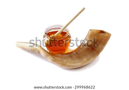 rosh hashanah (jewesh holiday) concept - shofar (horn) and honey isolated on white. traditional holiday symbols.  - stock photo