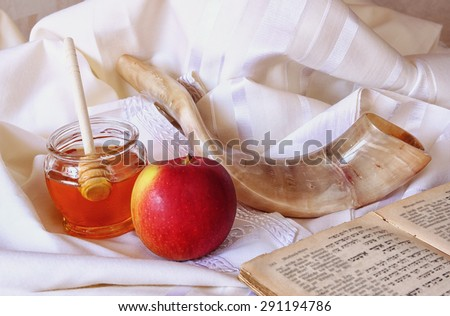 rosh hashanah (jewesh holiday) concept - shofar, torah book, honey, apple and pomegranate over wooden table. traditional holiday symbols.  - stock photo