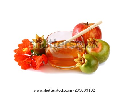 rosh hashanah (jewish holiday) concept - honey, apple and pomegranate isolated on white. traditional holiday symbols.