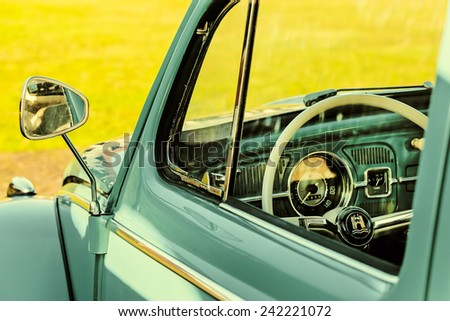 ROSMALEN, THE NETHERLANDS - JANUARY 4, 2015: Retro styled image of the interior of a Volkswagen Beetle from the seventies in Rosmalen, The Netherlands - stock photo