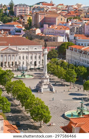 Rossio Square, Rossio with bronze fountain, and the typical Pombaline facades, Lisbon - stock photo