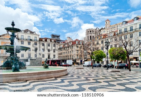 Rossio square with fountain located at Baixa district in Lisbon, Portugal - stock photo
