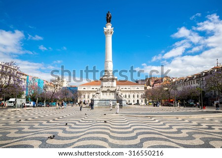 Rossio square with Statue of Dom Pedro IV, Lisbon Portugal - stock photo