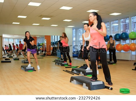 Rostov on Don - January 05: Beautifull female on the step board during exercise, Fitness center Orange,  Rostov on Don, Russia. January 05.2014. - stock photo