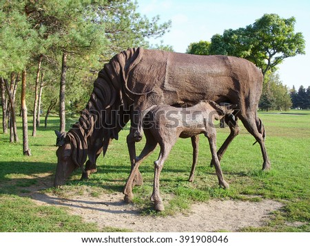 ROSTOV-ON-DON, RUSSIA - OCTOBER 12, 2008 - Iron horse sculptures in the park of the city - stock photo