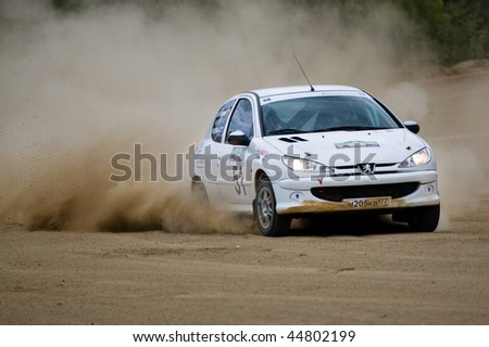 ROSTOV, RUSSIA - JULY 27: Roman Loginov drives a Peugeot  car during Rostov Velikiy Russian rally championship on July 27, 2008 in Rostov, Russia.