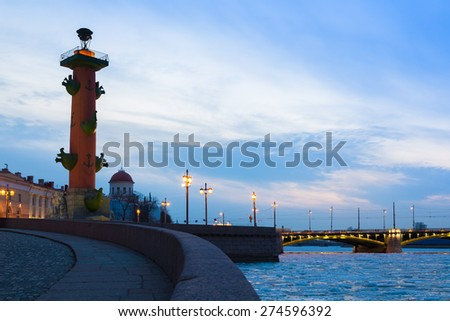 Rostral column and Birzhevoy Bridge (Exchange bridge) in St. Petersburg, Russia - stock photo