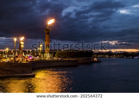 Rostral columns lit by illumination of the white nights at dawn, St. Petersburg, Russia - stock photo