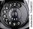 rotary dial of an old phone. - stock photo