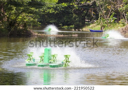 rotating oxygen blenders, water treatment, Aerator at surface speeds (Please see my footage of this photo at  http://www.shutterstock.com/video/video.html?id=11905817 ) - stock photo