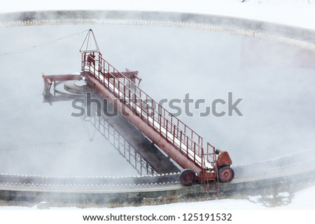 Rotation of filter in radial sedimentation tank with evaporation - stock photo
