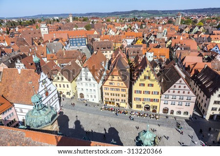 ROTHENBURG, GERMANY - APR 19, 2015: view to Rothenburg ob der Tauber, Germany. Rothenburg is well known for its well-preserved medieval old town. - stock photo