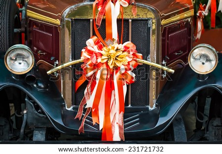 ROTHENBURG, GERMANY / EUROPE - November 17: Old fashioned red bus with a ribbon for the wedding ceremony in Thailand on November 17, 2014. - stock photo