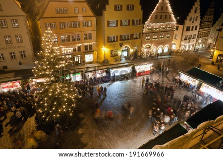 ROTHENBURG OB DER TAUBER, GERMANY - DECEMBER 22, 2013: Christmas Markets in central square by night in Rothenburg ob der Tauber, Germany - stock photo