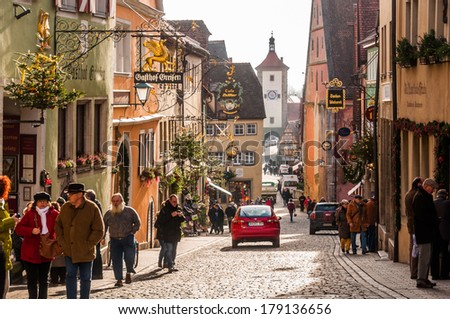 ROTHENBURG OB DER TAUBER, GERMANY - DECEMBER 3 2013:  Rothenburg Ob Der Tauber is a well preserved medieval german town, and a UNESCO heritage site which attracts over 2 million visitors every year. - stock photo