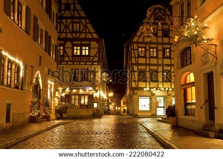 ROTHENBURG OB DER TAUBER, GERMANY - DECEMBER  22, 2012: Street View of Rothenburg ob der Tauber on Christmas. It is well known medieval old town, a destination for tourists from around the world.  - stock photo