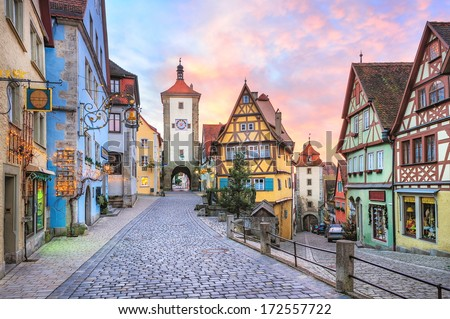 Rothenburg ob der Tauber, picturesque medieval city in Germany, famous UNESCO world culture heritage site, popular travel destination - stock photo