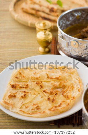 roti canai flat bread, very famous mamak food in malaysia, usually served wtih curry sambal or sugar