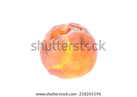 Rotten peach isolated on a white background - stock photo