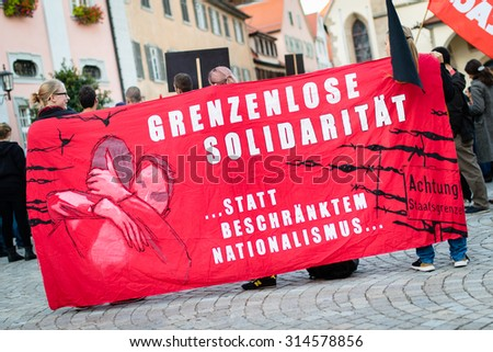 ROTTENBURG AM NECKAR, GERMANY - SEPTEMBER 8, 2015. Young people protest against racism and nationalism - stock photo