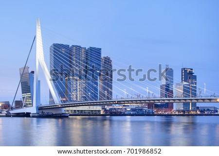 ROTTERDAM-AUGUSTUS 14, 2017. The Erasmus Bridge at dawn. The 284m long bridge was designed by Ben van Berkel (UNStudio) and connects Kop van Zuid with the city center. It has the nick name The Swan.
