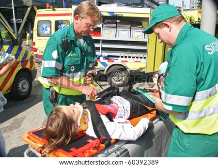 ROTTERDAM, HOLLAND - SEPTEMBER 5: Demonstration of ambulance personnel at the annual World Harbor Days in Rotterdam, Holland on September 5, 2010 - stock photo