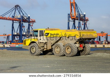 ROTTERDAM - JAN 13, 2012: Boskalis dump truck on the construction site of a new harbor in sea, called Maasvlakte 2, in the Port of Rotterdam.  - stock photo