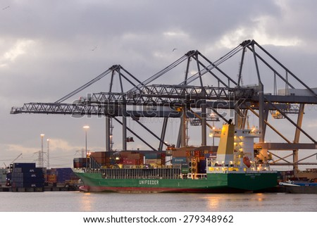 ROTTERDAM - JAN 13, 2012: Container ship moored at the ECT Terminal in the Port of Rotterdam. The port is the Europ's largest and facilitate the needs of a hinterland with 40,000,000 consumers. - stock photo