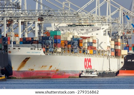 ROTTERDAM - JAN 13, 2012: OOCL Southampton container ship moored at a container terminal in the Port of Rotterdam.  - stock photo