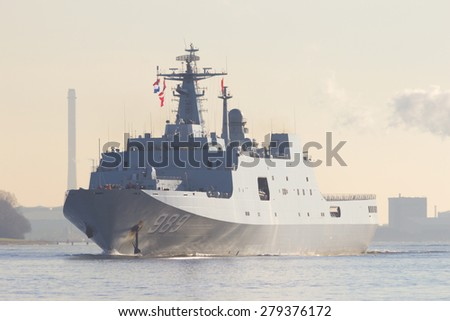 ROTTERDAM - JAN 30, 2015: The Chinese Navy amphibious transport ship Changbai Shan (989) leaving the Port of Rotterdam after the first visit ever of the Chinese Navy to The Netherlands. - stock photo