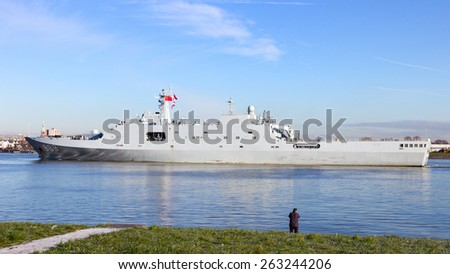 ROTTERDAM - JAN 30, 2015: The Chinese PLA Navy amphibious transport ship Changbai Shan (989) leaving the Port of Rotterdam after the first visit ever of the Chinese PLA Navy to The Netherlands. - stock photo
