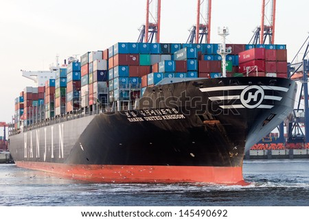 ROTTERDAM - JULY 9: Hanjin container ship leaving the Port of Rotterdam on July 9, 2013 in Rotterdam. Rotterdam port area is 105 square km and the largest port in Europe.  - stock photo