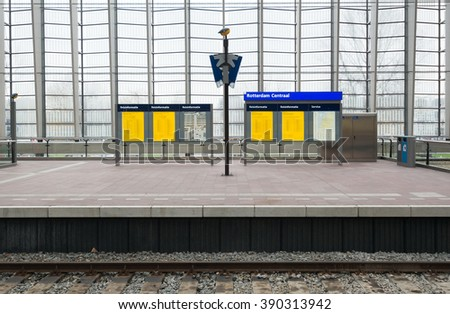 ROTTERDAM - JULY 19: Railway station platform of the Dutch Railway Company on 19 July, 2015 in Rotterdam, The Netherlands. The Dutch Railway operates 4,800 trains a day. - stock photo