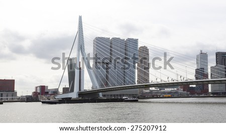 ROTTERDAM- MAY 1, 2015. Erasmus Bridge over the Maas, near by de Rotterdam Building and Maas tower, Kop van zuid, Rotterdam, the Netherlands. - stock photo