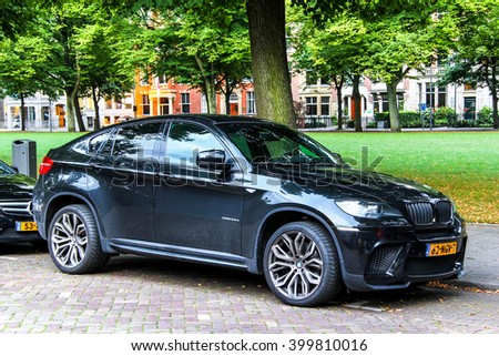 ROTTERDAM, NETHERLANDS - AUGUST 9, 2014: Motor car BMW E71 X6 in the city street. - stock photo