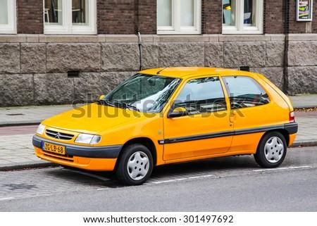 ROTTERDAM, NETHERLANDS - AUGUST 9, 2014: Motor car Citroen Saxo at the city street. - stock photo