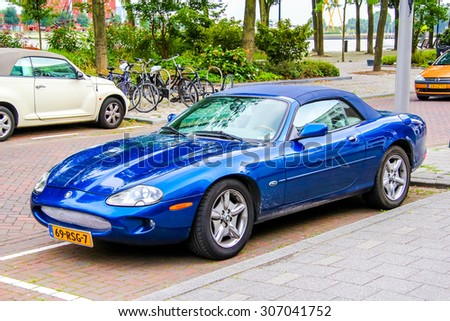 ROTTERDAM, NETHERLANDS - AUGUST 9, 2014: Motor car Jaguar XK at the city street. - stock photo