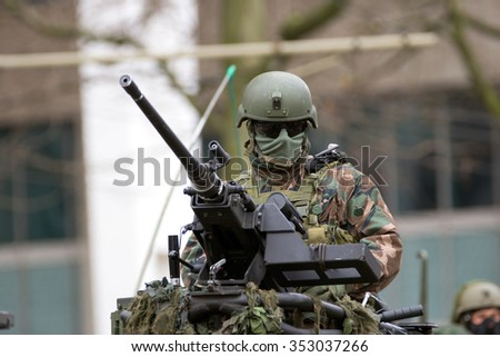 ROTTERDAM, NETHERLANDS: DEC 12, 2015: Soldier behind a heavy weapon during the celebration of 350 years Dutch Marine Corps (Korps Mariniers).