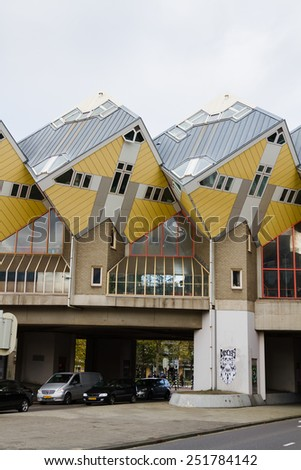 ROTTERDAM, NETHERLANDS - November 8, 2014 : Cube houses or Kubuswoningen in Dutch are a set of innovative houses designed by architect Piet Blom and built in Rotterdam, the Netherlands on Nov 8, 2014. - stock photo