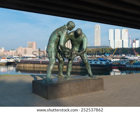 ROTTERDAM, NETHERLANDS - OCTOBER 4, 2014: Statue of two dike workers, created by Ek van Zanten. it symbolizes the cooperation in the fight against the sea