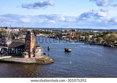 Rotterdam, Netherlands. Old lighthouse tower in harbor  - stock photo
