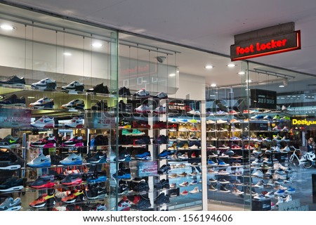 ROTTERDAM, NETHERLANDS - SEPTEMBER 21: Foot Locker shop on September 21, 2013 in Rotterdam. It is the successor of Woolworth with headquarters in New York, mainly selling sport shoes and clothes. - stock photo