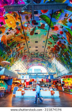 ROTTERDAM, NETHERLANDS - SEPTEMBER 03, 2015: inside of the market hall a residential and office building with market hall underneath opened on Oct 1, 2014, by Queen Maxima designed by architects MVRDV - stock photo